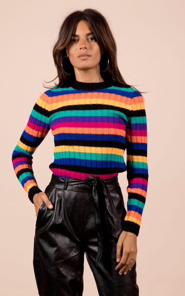 Model faces forward with hand in pocket wearing Kiki Jumper in multicolour stripe