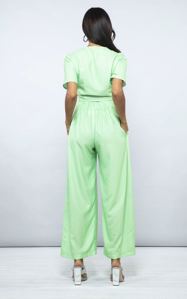 Model facing backwards wearing Chinchilla Pants in lime green by Dancing Leopard