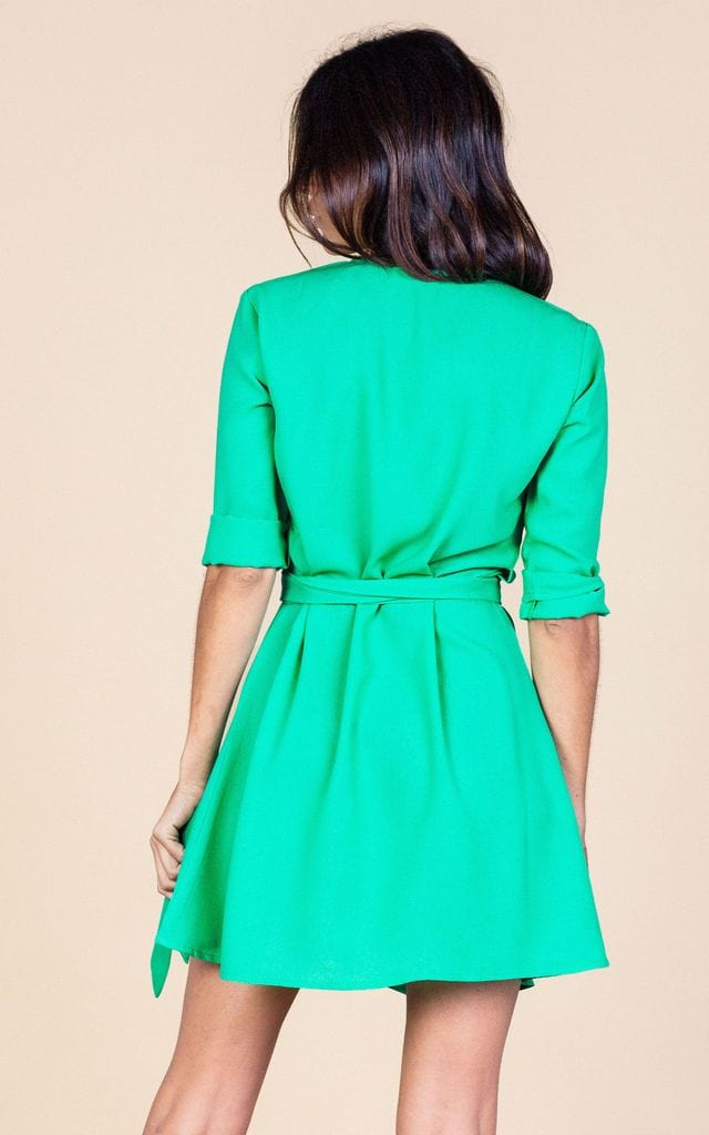 Backward-facing model wears Zeina Mini Dress in green