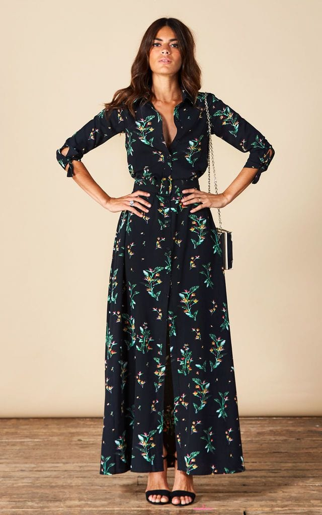 Model faces forward with hands on hips wearing Dove Dress in black floral print by Dancing Leopard