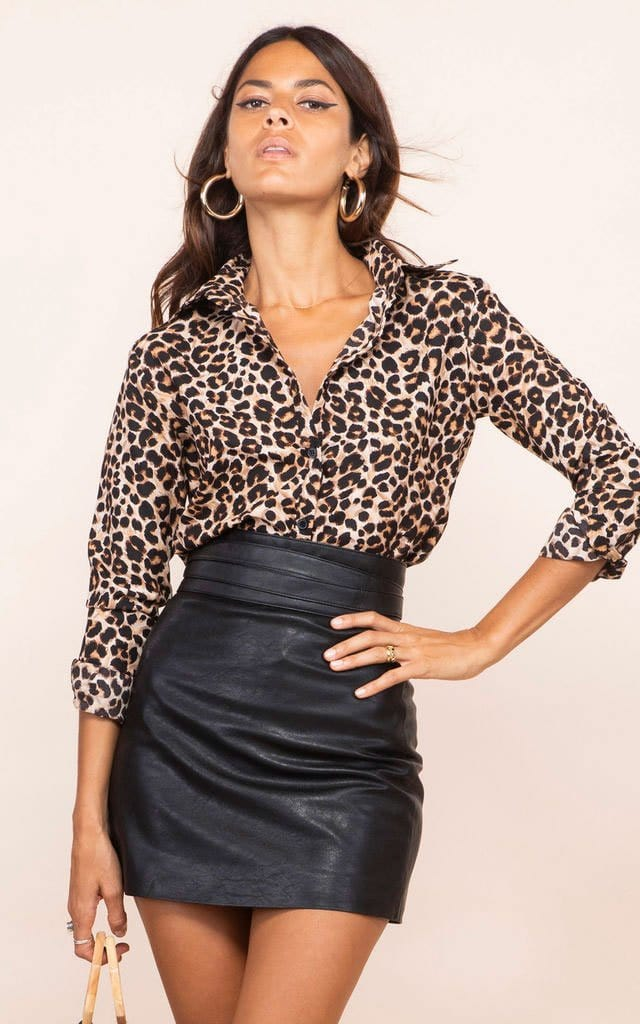 Dancing Leopard model faces forward with hand on hip wearing San Diego Shirt in leopard print