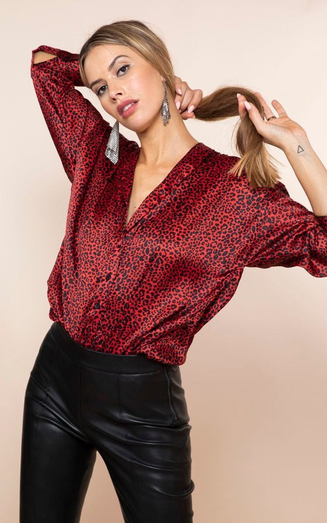 Front-facing model plays with hair wearing Dancing Leopard Monte Carlo Shirt in red leopard print