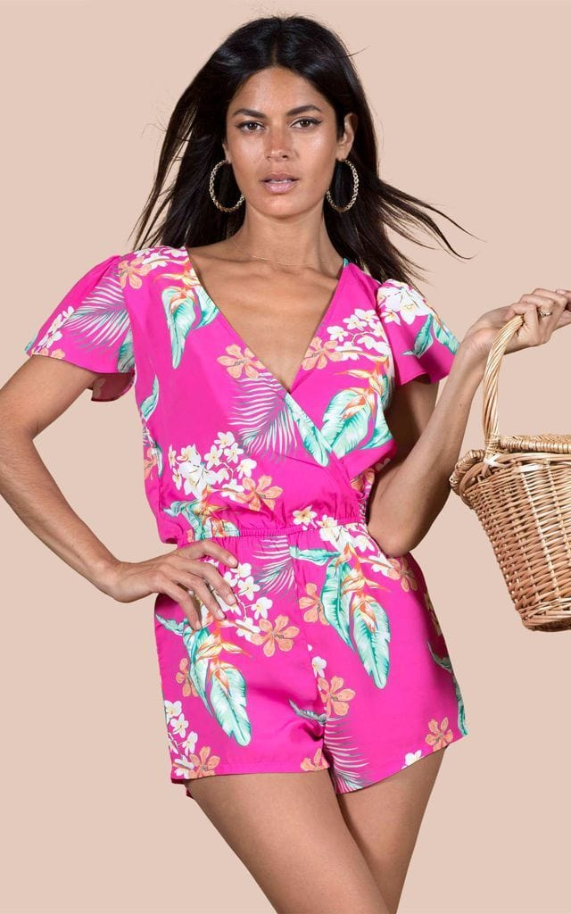 Dancing Leopard model poses with basket bag wearing Rio Playsuit in pink tropical print