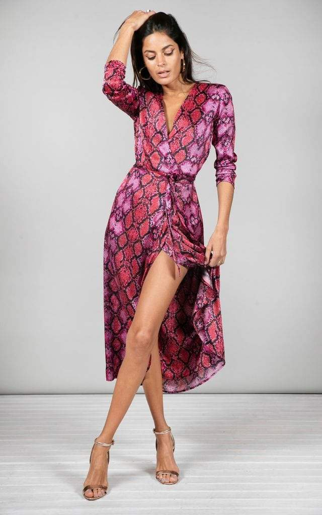 Dancing Leopard model faces forward wearing Yondal Dress in red snake print with heels