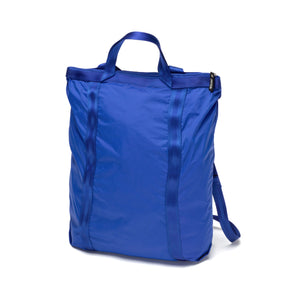 Bright blue travel shopper bag with backpack straps and handle on top