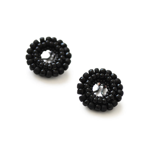 Japanese glass beads, hand-woven over sterling silver clips. Earrings come supplied with a removable silicon pad for ear comfort.