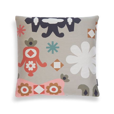 Square-shaped pillow with ornate graphics on a neutral colored backdrop