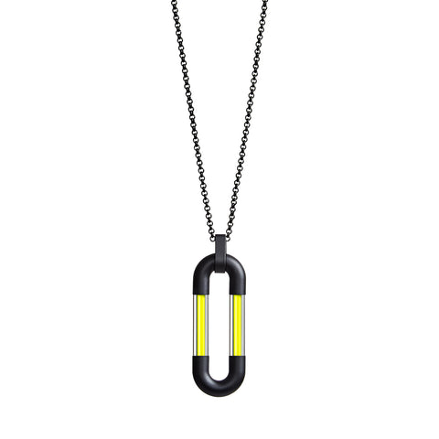 Black minimalistic ring chain with an oval centerpiece assembled form four parts: two black matt metal U-shaped elements interconnected with two thin lines of pure yellow pigment set in thick quartz tubes.