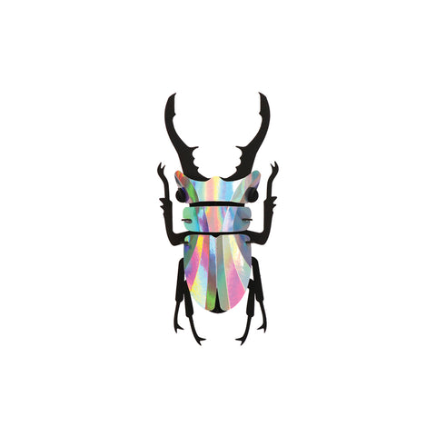 Assembled 3D Stag Beetle paper puzzle on a background. The beetle body, legs and pincers are made of matte-black cardboard. The iridescent shields are made of silvery metallic paper.