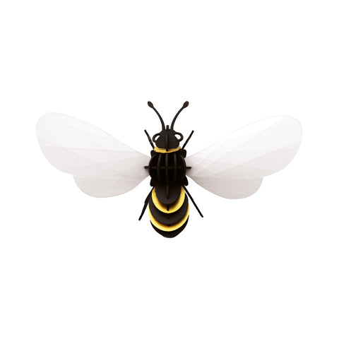 Assembled 3D Honey Bee puzzle on a white background. The bee body, legs and antennae are made of black cardboard with gold paper inserts. The wings are veined, white transparent paper.