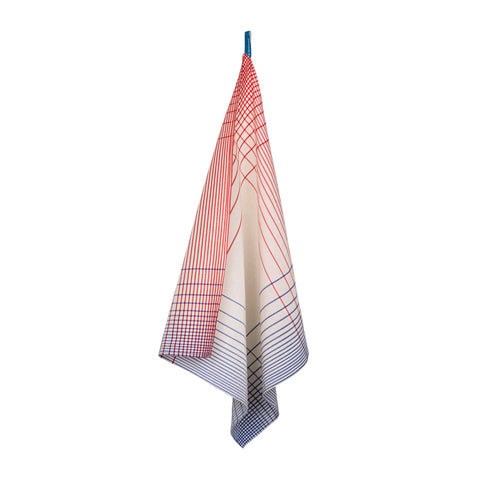 A hanging off-white tea towel with a red and blue graduated grid patter around the edges.