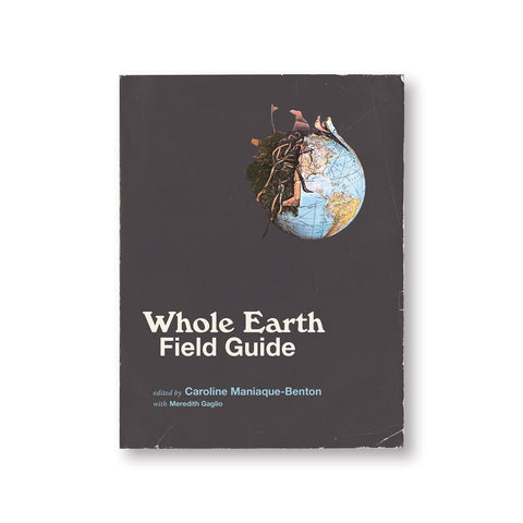 Dark gray book cover with illustration of a globe bursting with soil and worms. Title in white font near bottom