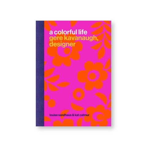 Book cover with a vibrant orange and magenta floral pattern, white and yellow san serif title at top and a navy spine
