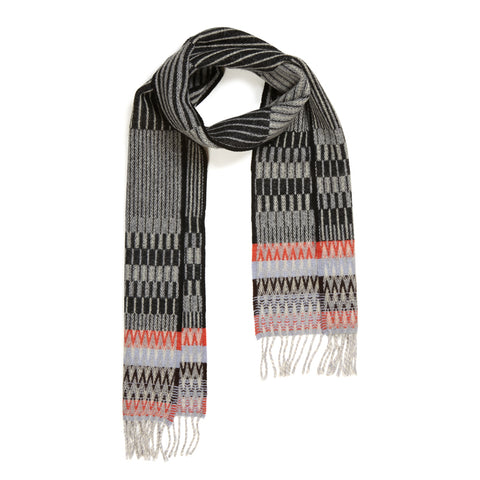Mono Furrow scarf with lengthwise black and gray interchanging pinstripes and contrasting stripes of red, lavender and black at either end, with gray fringe.