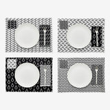 Four place settings laid out as a grid each showing how to mix and match the black and white Bitmap textiles.