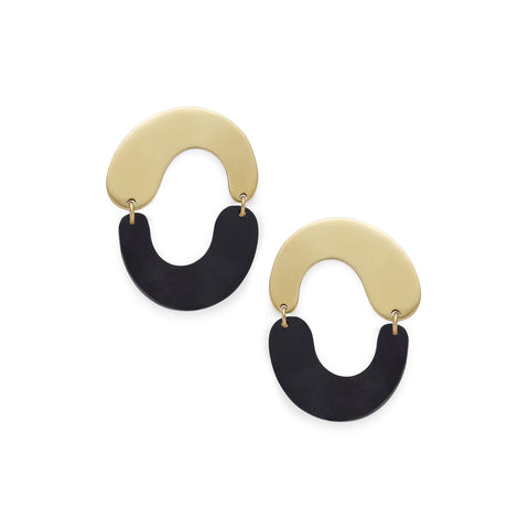Earrings with two sculptural u-shaped pieces linked together on either side. Top shape is brass and and upside-down U, bottom shape is a black horn U.