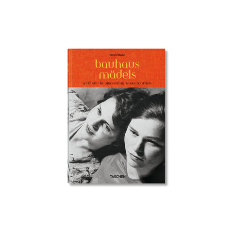 Book cover with an orange band across the top with the title in yellow lowercase serif font. Below is a black and white photo of two women leaning on to each other, looking off to the side, cropped at their shoulders.