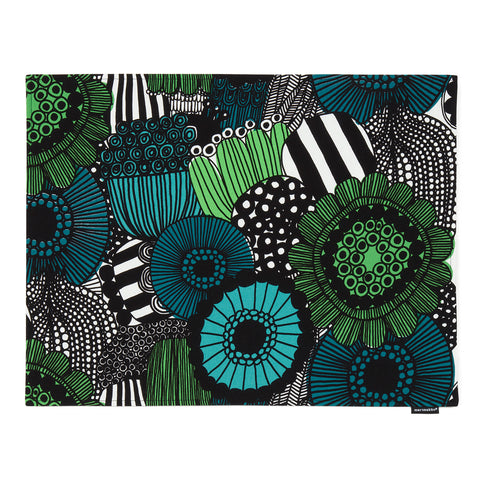 Placemat decorated with the lush floral Pieni Siirtolapuutarha (Small City Garden) pattern, overflowing with brightly-colored, abstract flowers in green, turquoise and teal.