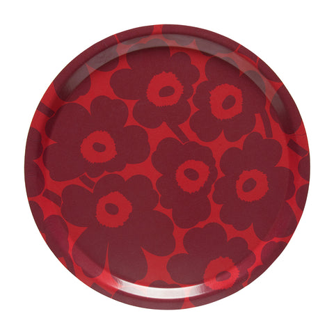 Round, laminated birch plywood tray with easy to grip lip,  decorated with a lush floral pattern of dark red flowers on a bright red background.