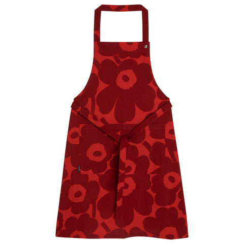 Finnish Designer Maija Isola's Pieni Unikko (poppy) apron is gorgeous in the kitchen or garden. 100% cotton, with a front pocket, adjustable neck strap and ties at the waist, the bright red background is covered in large, dark red flowers.