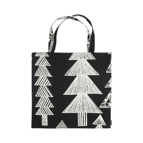 Kuusikossa Tote Bag, Versatile cotton tote with two handles features  black and white spruce trees recalling a magic forest where every tree is different. Lightweight and easy to tuck into another bag.