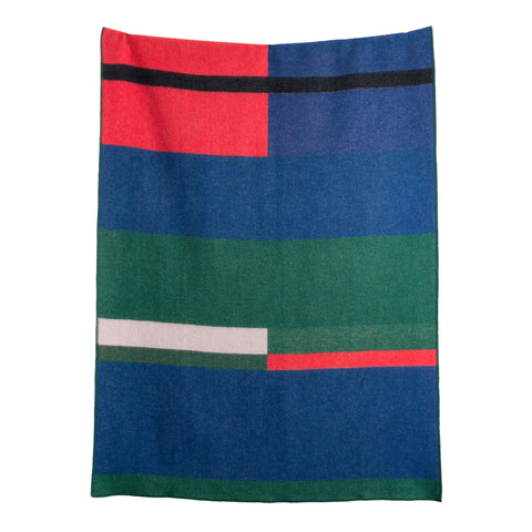A blanket with a dark multi-colored geometric motif