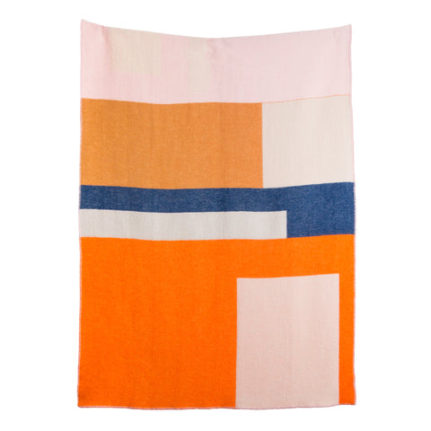 A blanket with a light multi-colored geometric motif