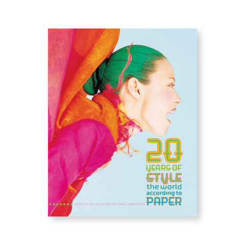 "Book cover featuring a photo of a model with green hair and magenta clothing screaming, in profile. Stacked, colorful text at bottom right reads ""20 Years of Style The World According to Paper"""