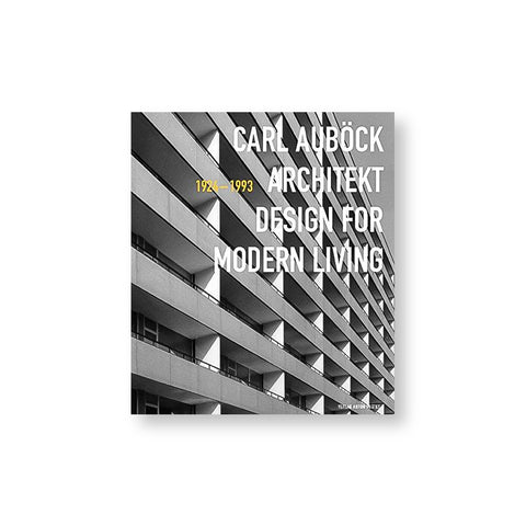 Book cover with photograph of a gray modernist building and title overlaid in white sans serif letters