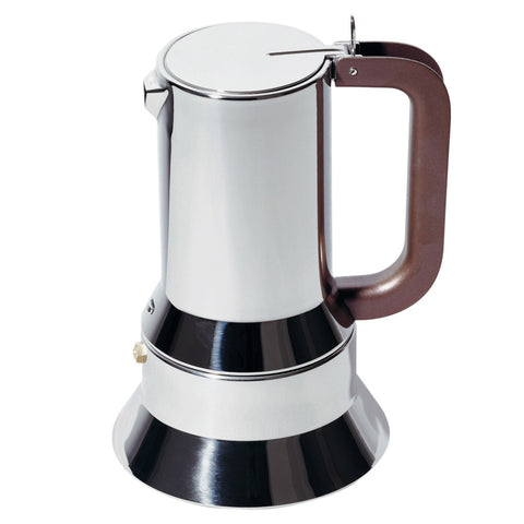Side shot of mirror-polished espresso maker with copper handle on white background.