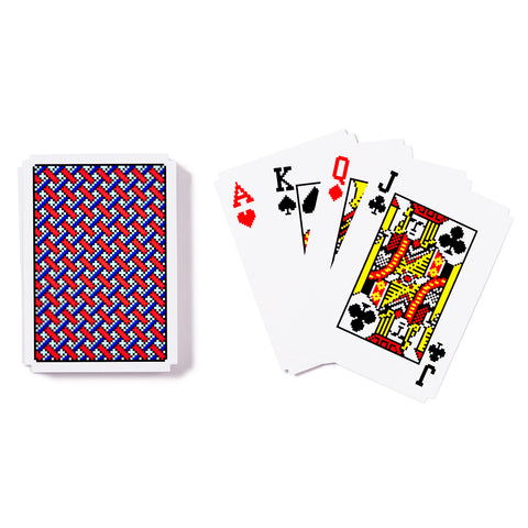 A deck of playing cards, halved and placed on a white surface. The left half displays the playing cards back, which features a digitized grid like graphic in red, blue, and green, with a white framed border. The right half displays the faces of four different cards that are stacked and slightly spread apart.