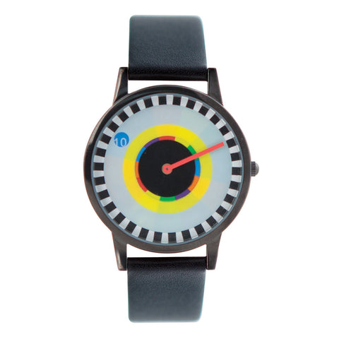 Close up of Milton Glaser Sprocket Watch with black leather band, black case and watch face with multi colored  disk which  turns to reveal the hour, while the red hand reveals the minutes