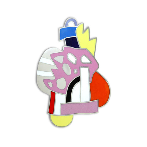 A brooch with an abstract composition of hand-drawn shapes in red, pink, yellow and blue.