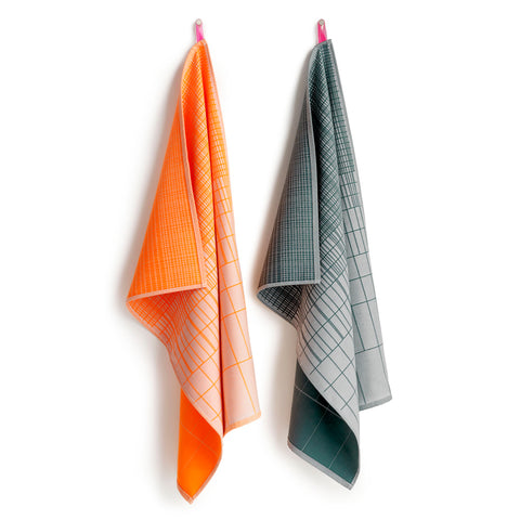 A set of orange, and gray towels hanging on a hook, each featuring a grid pattern.