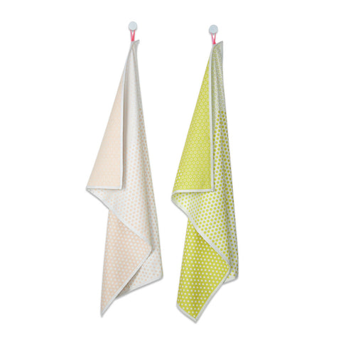 Two hanging tea towels, one in shades of gray and the other in shades of yellow. Each towel is decorated with a micro dot pattern.
