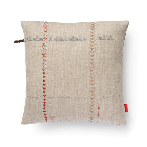 Two horizontal and vertically striped embroidery detail that create a grid like design. Embroidery stitched in red, bronze, and silver against a natural backdrop.