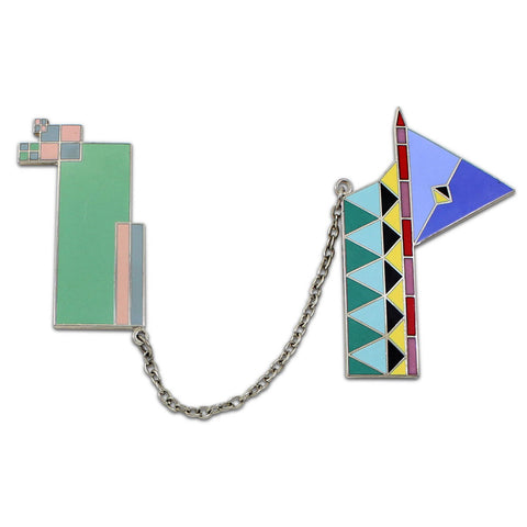A brooch is assembled from two abstract, brightly colored plates with a chain.
