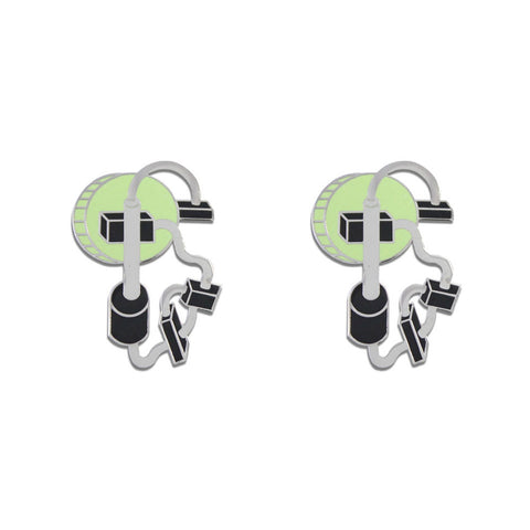A pair of earrings with abstract forms with green, grey, and black enamel.