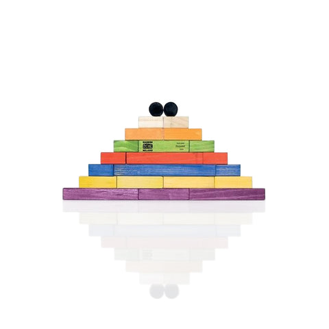 Twenty colorful wooden rectangular blocks placed on one on top of another to shape a pyramid. The colors include purple, yellow, blue, red, green, orange, natural wood, and black.
