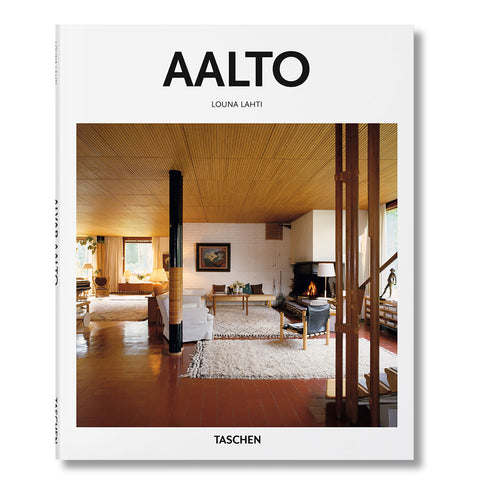 White book cover with photograph of a cozy architectural interior with brown flooring white rugs and wooden furniture. Title above in a black sans serif letters