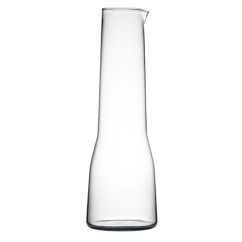 Clear Carafe shown in profile on a white background, with a long, elegant neck tapering upward from a graceful bell shaped bottom.