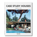 White book cover with photograph of a modernist house with a pool in the foreground where two figures are lounging. Title above in black sans serif letters