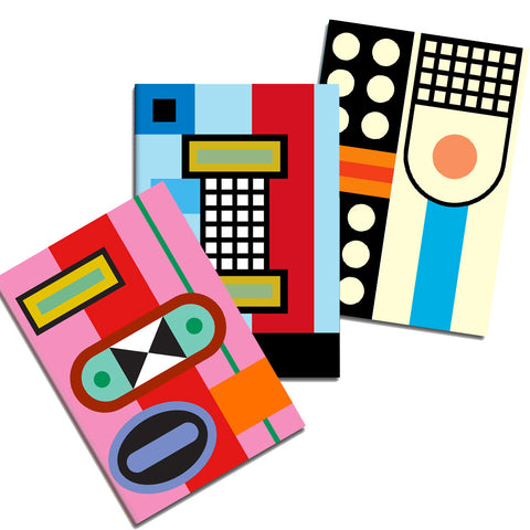 Three notebooks fanned out, each with different bold multicolored graphic pattern.