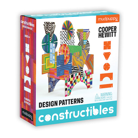 Box with brightly patterned sides and a picture of patterned pieces interlocked to create a freestanding structure as well as flat outlines showing the five different shapes of the pieces