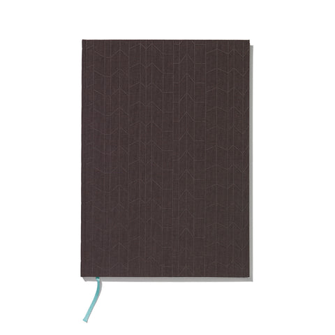 Book cover designed from heavy cardboard covered with dark brown linen embossed with vertical geometric pattern.