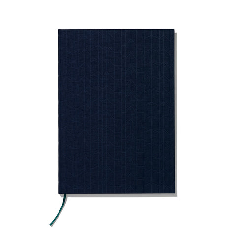 Book cover designed from heavy cardboard covered with dark navy blue linen embossed with vertical geometric pattern.