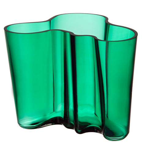 Emerald Aalto Vase,  A modern classic, its' undulating shape alludes to the untamed shorelines of Finland's thousands of lakes. Mouth-blown glass, in emerald green, 6.25 inches.