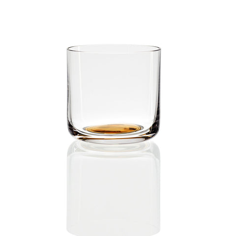 Single glass in profile about as tall as wide with rounded bottom featuring an amber gold circle