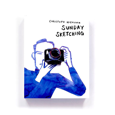 White book cover with deep blue watercolor sketch of a figure holding a camera rendered in photographic detail