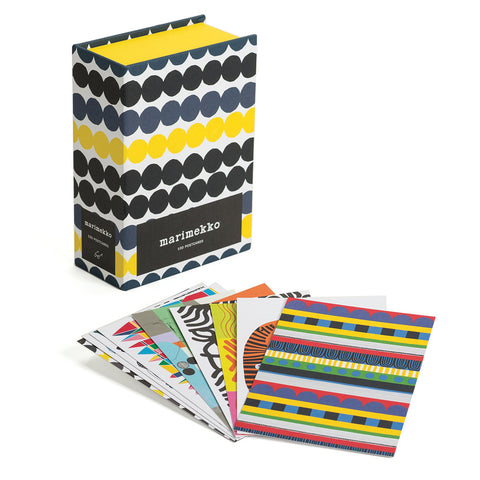 Box with black gray and yellow linked dot pattern behind a fan of postcards with different colorful patterns